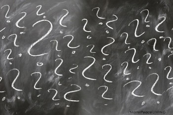 Question marks on chalkboard